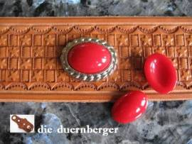 a) Muggelstein rot oval Zierniete - Bild vergrößern